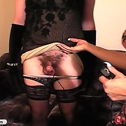 Blonde milf spanks boy in dress