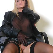 This hawt golden-haired plays rubs her twat with leather covered fingers