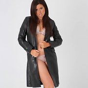 Sexy Leanna is wearing a full length leather coat
