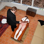 Severe strapping for a stunning young schoolgirl
