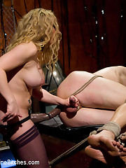 The blonde dominatrix fucked and smothered a tied man