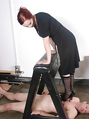 Mistress tramples by heels