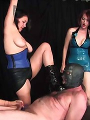 A trio of dominatrixes works over a penitent captive