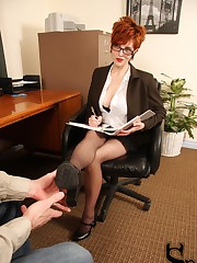 While she considers hiring him, she teaches him how to properly worship her feet.
