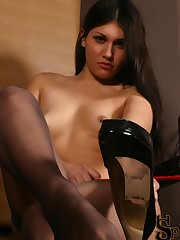Jade sitting in a throne wearing nothing but thigh high stockings smacks her foot slave with a....