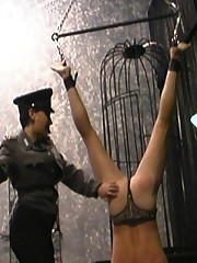 Hot Femdom in Uniform hangs and punishes man-slave