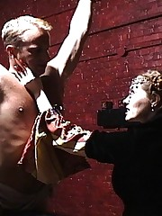 Two cruel bitches torture captured spy in their dungeon