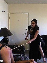 Tough Femdom in black beats him with whips and paddle