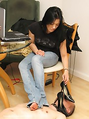Boy dominated by heels in office