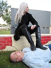 Blonde mistress tramples a slave