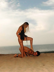 Blonde bitch walks her dog-slave on the beach, sits on his face and lashes him for bad behavior