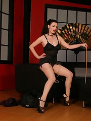 Cross dressed house boy lets a domina wax him