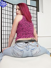 Redhead in jeans to be under them