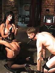 Mistress Carmen takes great care in the inflicting pain on her subs