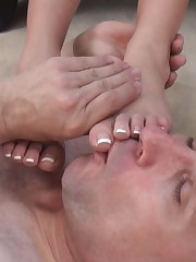 Two ladies like when their slaves lick their feet