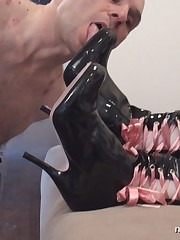 Obedient slave made cleaning Mistress's boots with his tongue