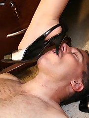 A slaveboy is under feet