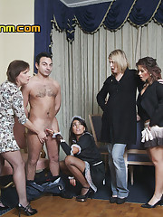The poor guy has all five of the girls taking turns on his cock