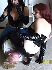 Latex clad babes use their asses tyo beat up their photographer