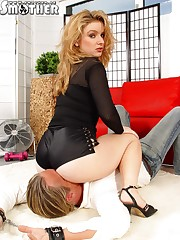 Blond babe was sitting at lying man's face.