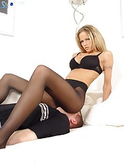 Girl in sexy lingerie was sitting at the slave's face.