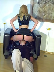 Latex babe likes to feel her slave under her bootie