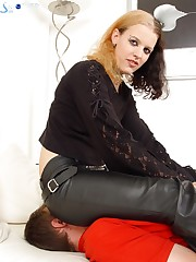 Hottie in leather pants sitting on her sub's nose