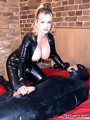 Rubber mistress and her slaveboy