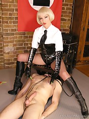 Mistress, weared in leather boots, tormented slave
