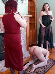 Two fierce FemDoms abuse a slave boy's cock and balls with w...