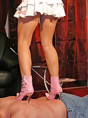 Male was trampled by pink and black heels
