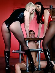 Mistresses Alexis Grace and Lexi Sindel abuse their caged and chastised slave bitch