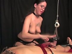 Mistress seems pleased with herself as she stretches her slave's balls and nipples and tortures him