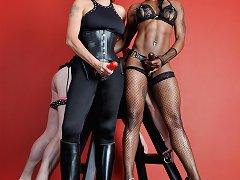 The ebony and white strapon mistresses uses a slaveboy