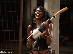 Ebony Mistress bounds and fucks her slaves with drilling machine