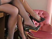 Some beautiful ladies wearing lace top stockings and high heels