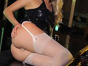 Hayley-Marie flashes her lacey white lingerie and stockings from beneath her tight black dress