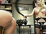 Jynx is bent over and has her beautiful round ass spanked red in an OTK spanking