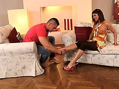 Brunette Bellina doing a footjob