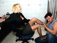Hot sexy cop Krissy gives a lucky jail bird a nice footjob