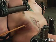 Tough girl spread bound to the floor. Excruciating custom nipple clamps and pussy torment keeps this pain slut in line until she deserves an orgasm.