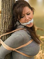 gagged and strapped to the tree