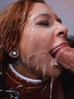 Busty redhead cum whore gets covered in a face full of cum!