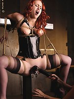 Vicky Van Warren Bound to a steel cross with pussy clamps
