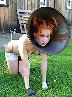 Pretty redhead coned and caged like a naughty puppy.