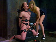 Mistress uses cattle prod on bound slavegirl.