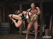 Blonde in fetish gear suspended and fucked.