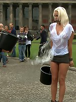 Humiliated blonde sucks cock in public.