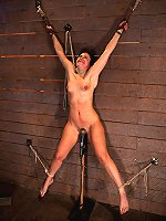 Girl bound spread-eagle on the wall and forced to cum.