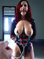 Redhead in latex blindfolded and disciplined.